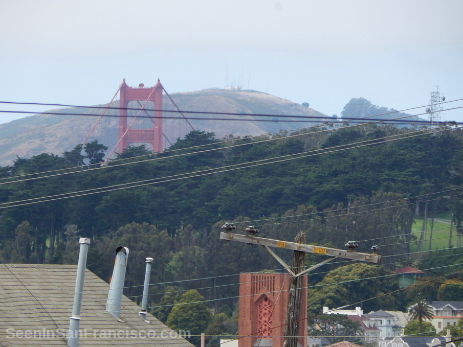 top of golden gate bridge tower from distance